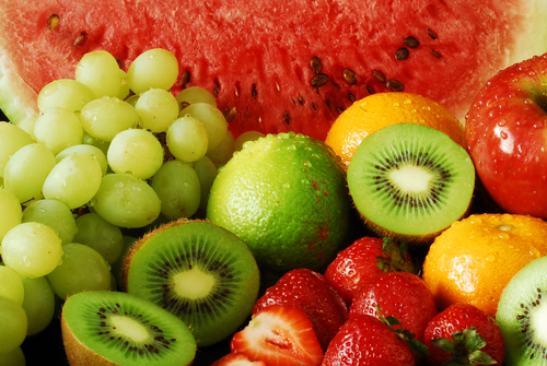 Colorful fresh group of fruits for a balanced diet. Black background. Look at my gallery for more fresh fruits and vegetables.